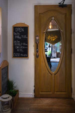 Wooden store door with the label detail