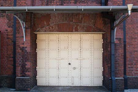 White iron door on the brick around