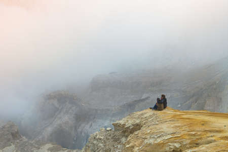 Young men/women sitting on mountain for trekking/traveling/hiking in nature mountain,  traveling for freedom lifestyle with relaxation life outdoor on vacation/holiday concept Archivio Fotografico