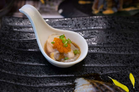 Fresh scallop oyster at sushi shop