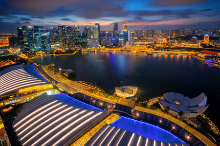 Singapore Marina Bay rooftop view with urban skyscrapers at night on 12 Feb 2017, in Singapore