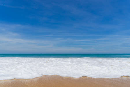 Blue sea and white wave sand