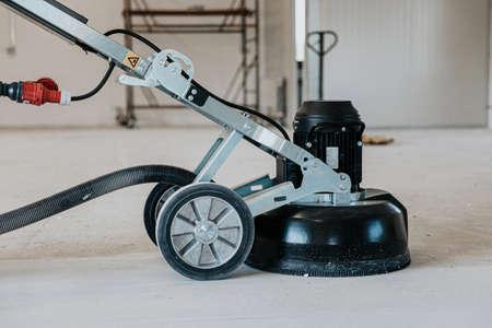 machine polishing surface floor smoothing and finishing hardener or epoxy concrete in the factory Stock Photo