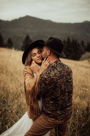 Stylish young and beautiful couple  photographed outdoors in the mountains at their elopement. Banco de Imagens