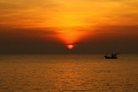 Sunrise at Puktien Beach, Petchburi Thailand photo