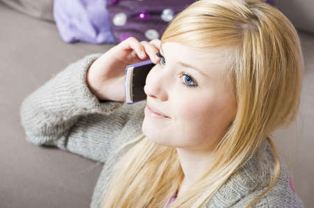 Pretty young woman on the phone with cell phone Stock Photo