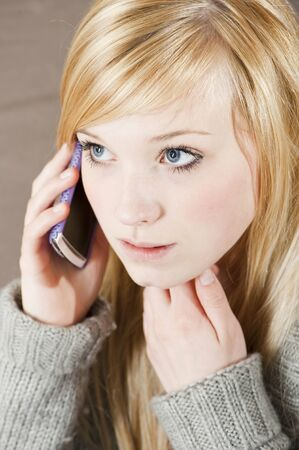 Pretty young woman on the phone with cell phone photo
