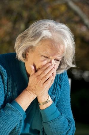 Senior woman having flu photo
