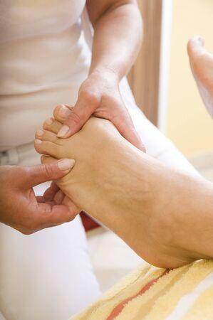 Feet massage Stock Photo - 17498679