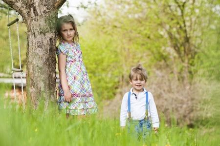 Children under a tree Stock Photo