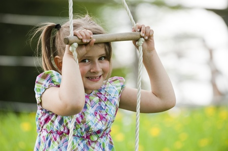 rope ladder: Little girl playing on a rope ladder Stock Photo