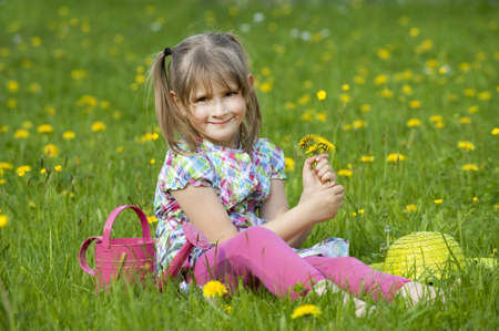 Little girl in a spring meadow photo