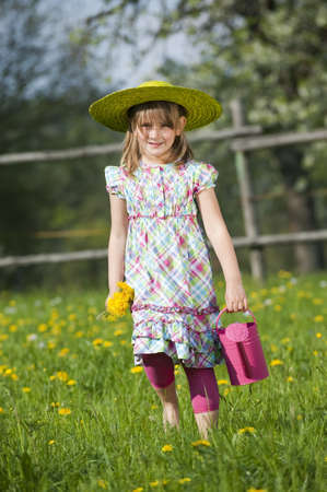 cull: Little girl in a spring meadow Stock Photo
