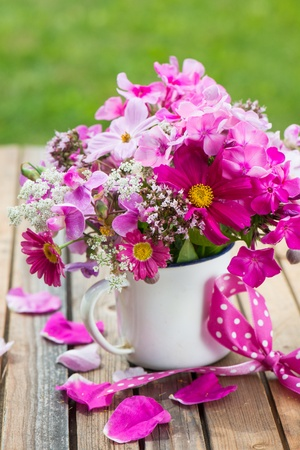 daisys: Pink garden flowers in a old cup