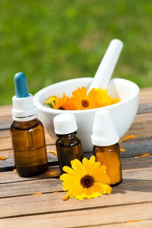 Alternative medicin with calendula flowers photo