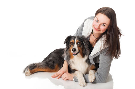 Young woman with australian shepherd dog photo