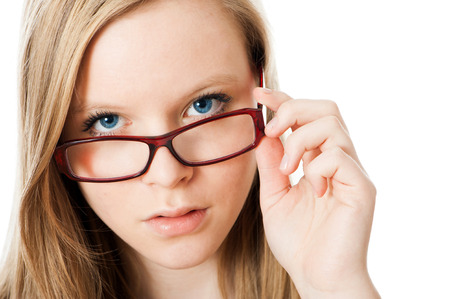 Teenage girl with eyeglasses isolated on white photo