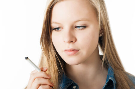Teenage girl with cigarette isolated on white photo