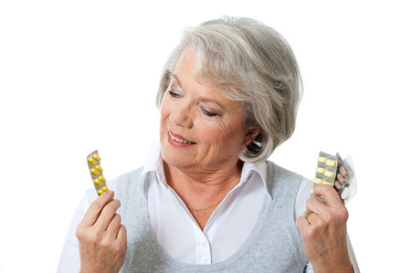 ingestion: Older woman with many tablets