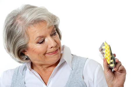 older woman: Older woman with many tablets