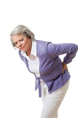 Senior vrouw met rugpijn Stockfoto