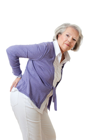 Senior woman with back pain photo