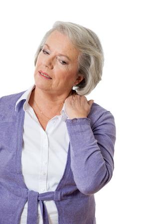 Senior woman has neck pain photo