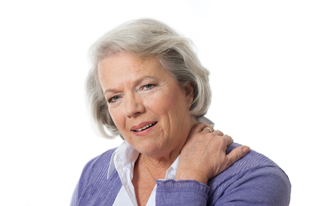 senior man on a neck pain: Senior woman has neck pain Stock Photo