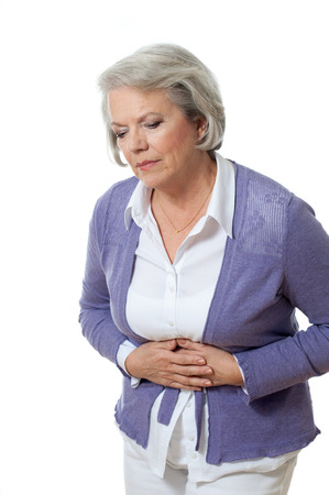 Senior woman has bellyache photo