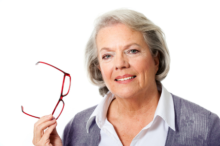 older woman: Older woman with glasses isolated on white