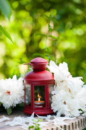 red lantern: Red lantern with white flowers