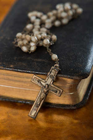 Old bible with crucifix