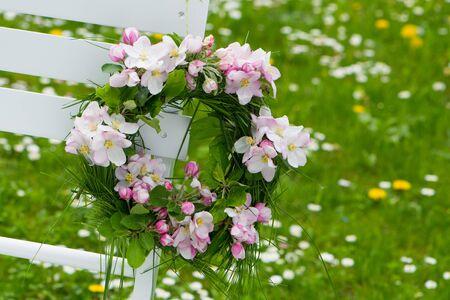 Apple blossom wreath on a garden chair