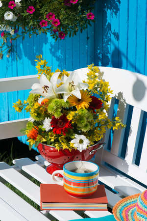 Colorful flower bouquet on a garden bench