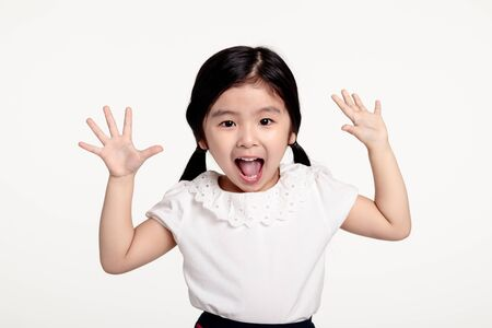 A studio portrait of an asian girl with a surprised look at something 免版税图像