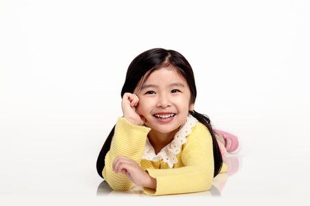 Studio portrait of Asian girl making a happy smile