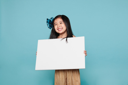 Asian girl holding a billboard