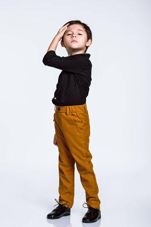 Studio full-length portrait of a boy doing a nice pose, casual dress