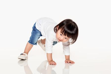 A studio shot of a Korean girl young child