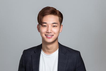 Studio Portrait of East Asian Businessman in Suit
