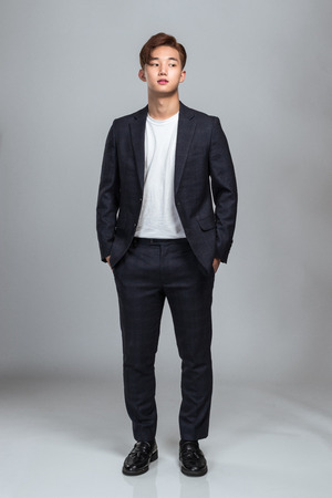 Studio portrait of a confident young East Asian business man