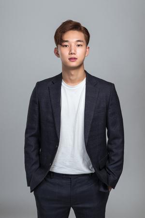 Studio portrait of a young Asian man
