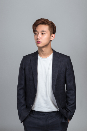 Studio portrait of a young Asian man