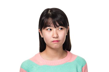 Studio portrait of a teenage East Asian woman looking sideways