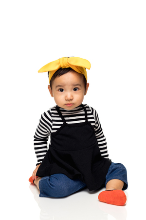 Studio portrait of lovely asian little girl child