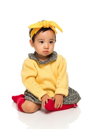 Studio portrait of serious asian little girl child