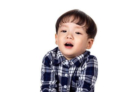 A studio portrait of a happy and playful asian boy child
