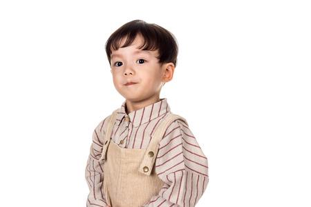 Studio portrait of sincere but mischievous asian boy child