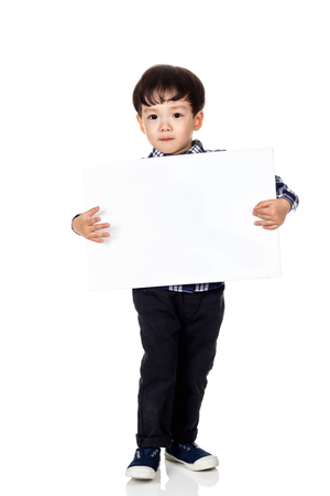 A studio portrait of an asian male child playing with a megaphone Archivio Fotografico