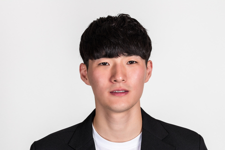 Portrait of a East Asian man in a studio top of a business man